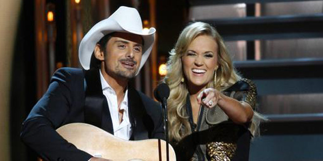 Brad Paisley and Carrie Underwood perform sing duet mock mocking mocked skewer hilarious awesome parody spoof satire hit ode watch Obamacare by Morning at 47th Annual CMA Awards November 6, 2013 Country Music Association ABC Reuters