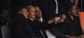 Obama self selfies President Barack Prime Minister David Cameron United Kingdom UK British Great Britain Helle Thorning-Schmidt Denmark Danish PM Nelson Mandela memorial service photoshop funeral Johannesburg South Africa African former Michelle First Lady wife self taking picture photograph pic themselves smiling snapping posing camera phone smartphone iphone narcissist narcissism death stadium world leaders media