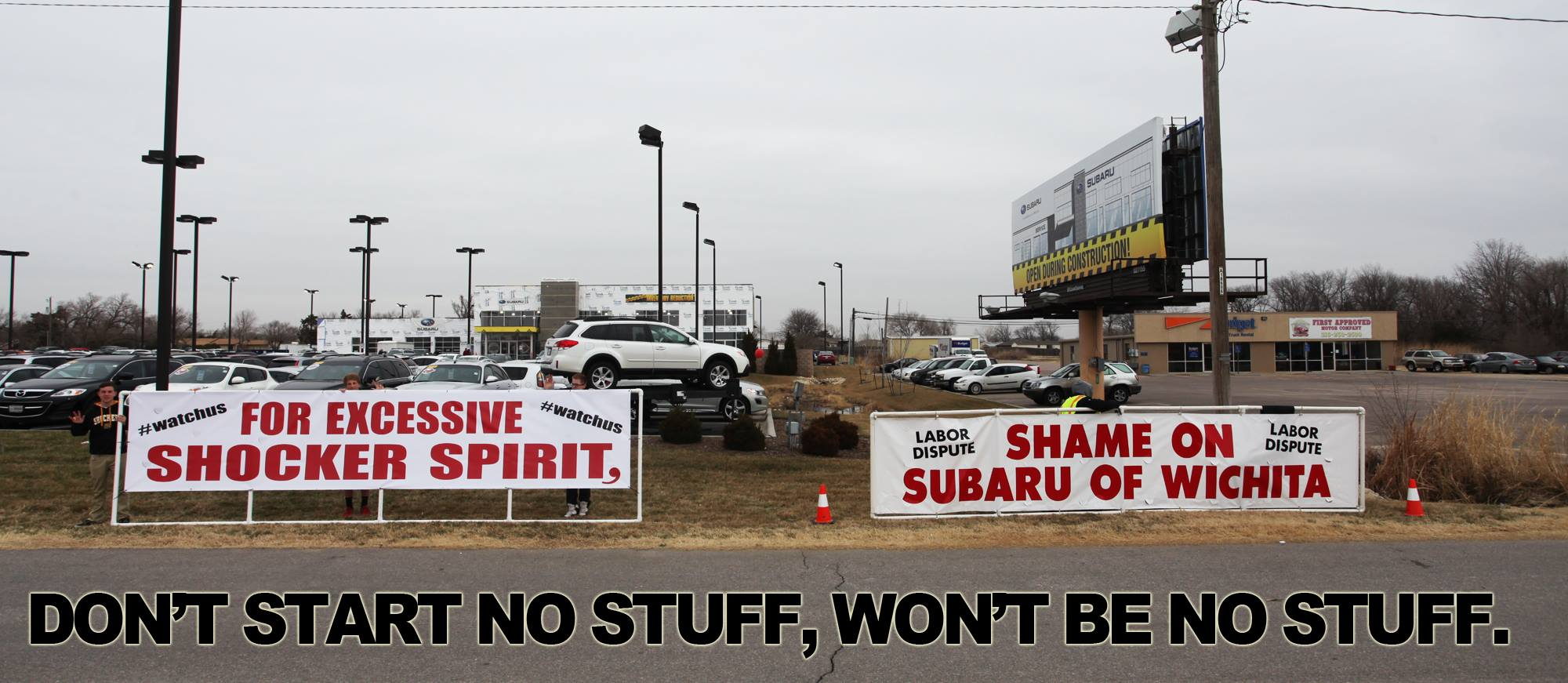 """For Excessive Shocker Spirit"" ""Shame on Subaru of Wichita"" banner union protesters protest signs sign auto car dealership dealer automobile Kansas KS labor dispute fights back fight battle respond responds handle handled handles clever cleverly Carpenters Local 201 non-union workers large white banner shame drywall company construction project bullying tactics contractors wages business businesses goons rats"