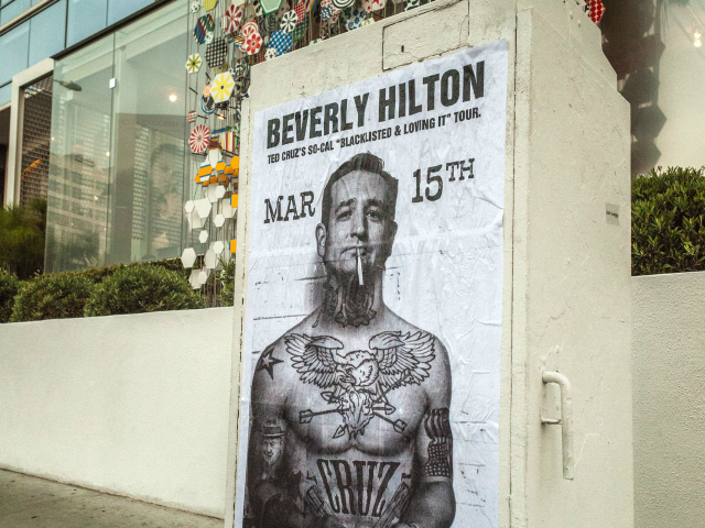 Posters Ted Cruz subversive street art tattoos tattoo tattooed photoshop photoshopped Senator Texas conservative Republican Tea Party appear show up pop put go Beverly Hills Los Angeles, CA California The Claremont Institute mysterious keynote speaker Beverly Wilshire Hotel March 15th body cigarette dangling lips mouth shirtless muscles plastered Dinner in Honor of Sir Winston Churchill traffic signal box