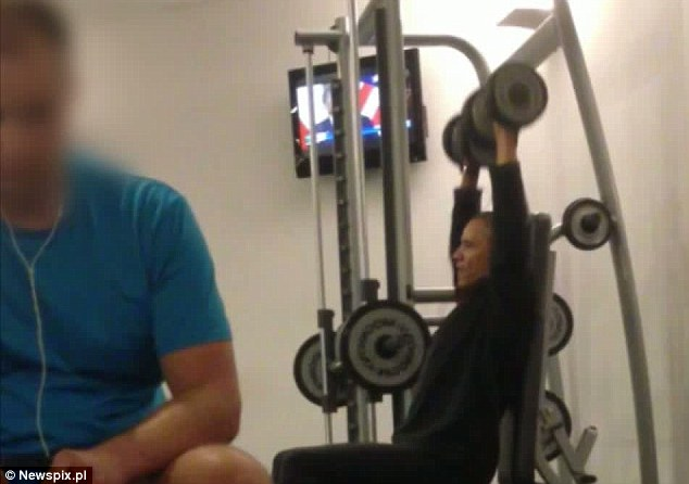President Barack Obama Workout Video Pictures pics photos images Routine Polish gym Poland hidden camera Secretly Recorded photographed snaps snapped Warsaw Marriott private security breach unauthorized taken took leaked working out exercising lifting weights pumping iron girl girly man weak wimp weakling tabloid 5-pound 10-pound dumbbells shots
