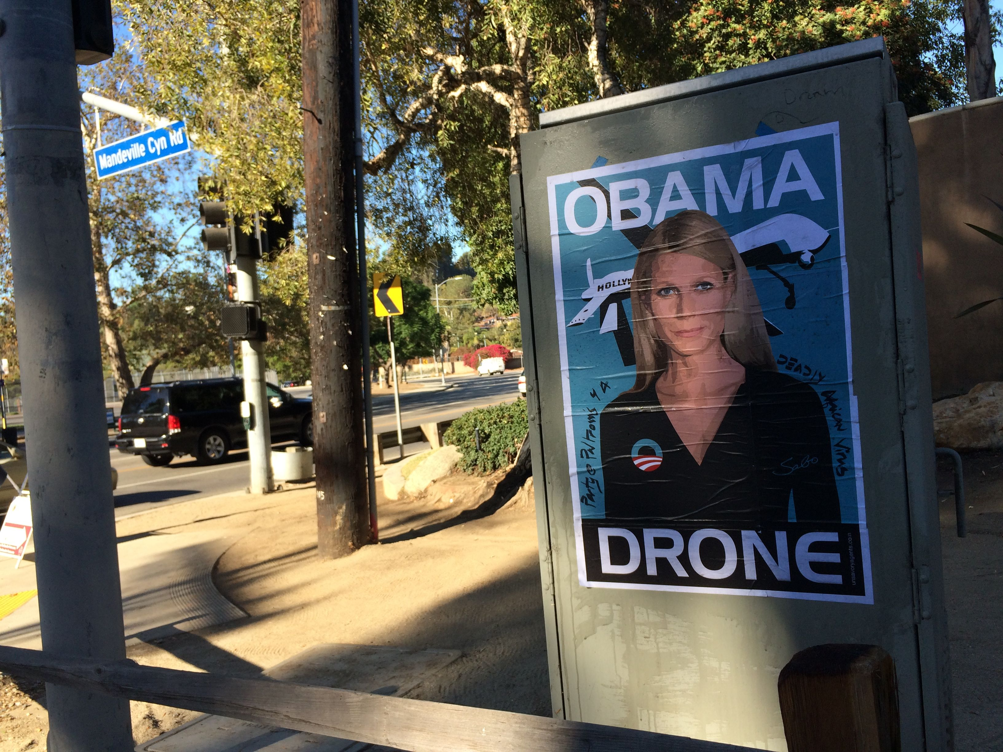 Gwyneth Paltrow Obama Drone posters poster Sabo President Obama DNC fundraiser L.A. Los Angeles Brentwood neighborhood neighbor neighbors hang hanging hung signs plaster plastering plastered traffic signal box boxes lamp posts bus benches anonymous conservative street artist provocative controversial subversive Unsavory Agents UnsavoryAgents outside political Democrats Democrat drones Predator plane planes flying background actor actress house host hosting gala her home