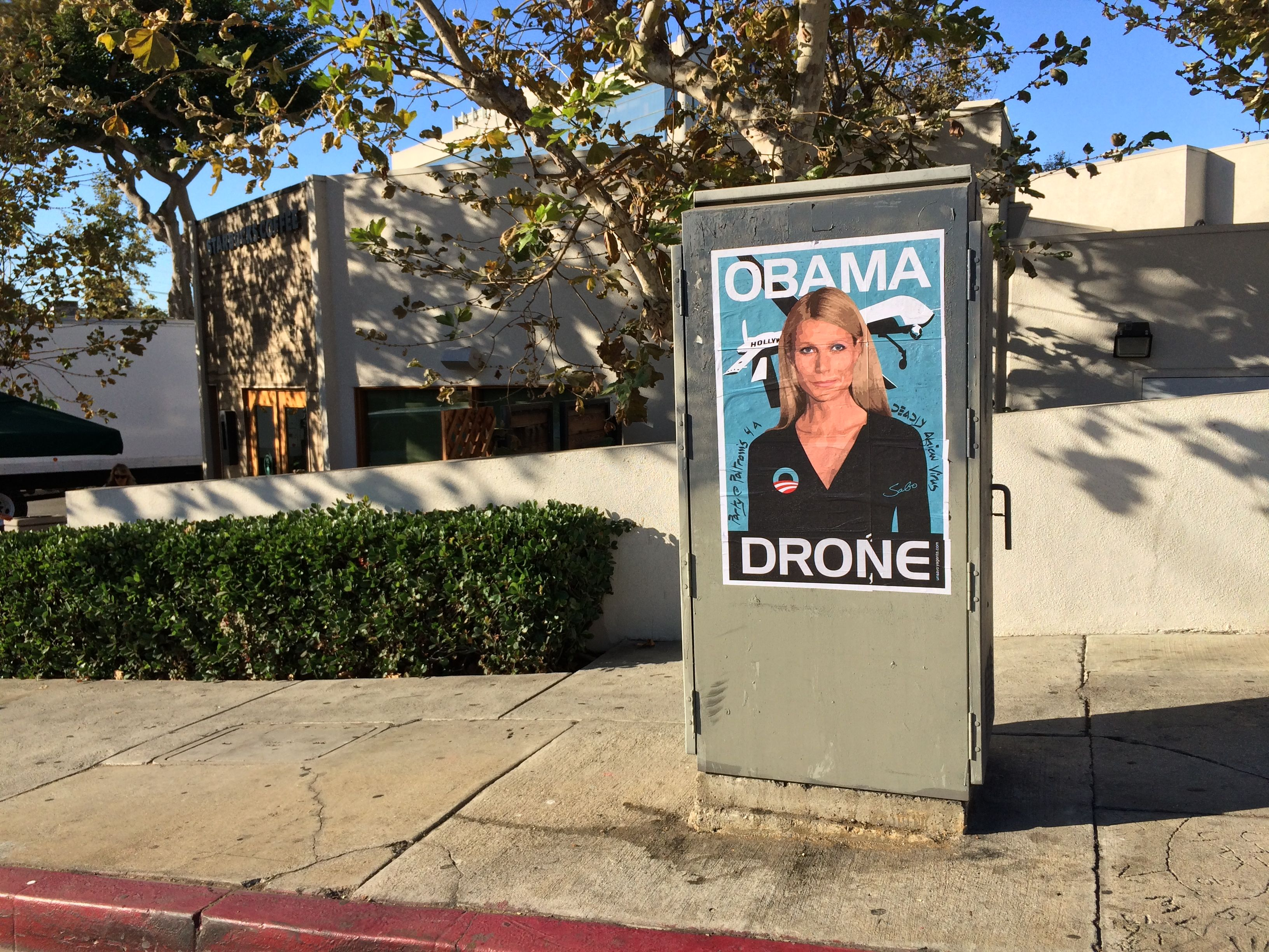 Gwyneth Paltrow Obama Drone posters poster Sabo President Obama DNC fundraiser L.A. Los Angeles Brentwood neighborhood neighbor neighbors hang hanging hung signs plaster plastering plastered traffic signal box boxes lamp posts bus benches anonymous conservative street artist provocative controversial subversive Unsavory Agents UnsavoryAgents outside political Democrats Democrat drones Predator plane planes flying background actor actress home house host hosting gala
