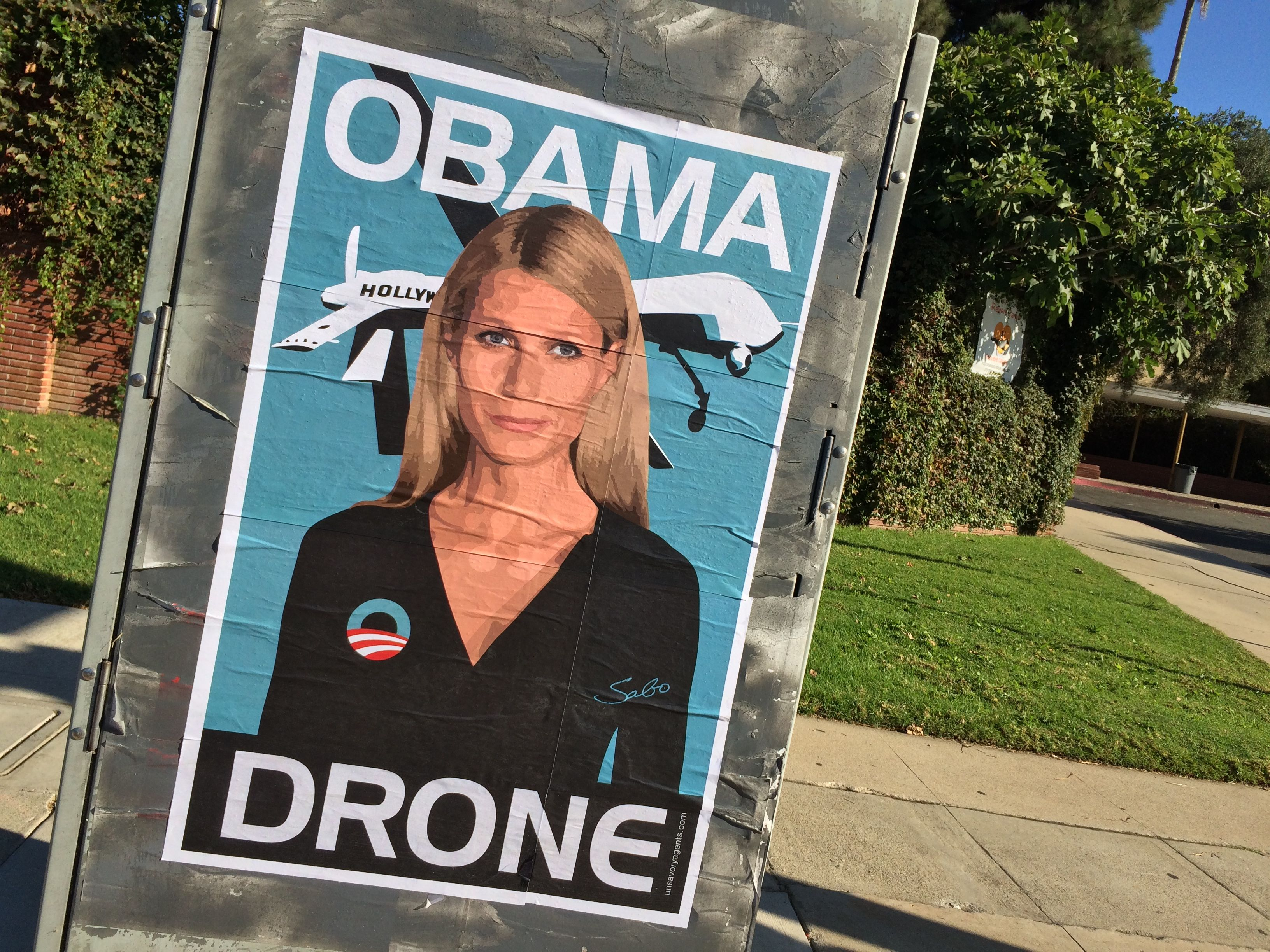 Gwyneth Paltrow Obama Drone posters poster Sabo President Obama DNC fundraiser L.A. Los Angeles Brentwood neighborhood neighbor neighbors hang hanging hung signs plaster plastering plastered traffic signal box boxes lamp posts bus benches anonymous conservative street artist provocative controversial subversive Unsavory Agents UnsavoryAgents outside political Democrats Democrat drones Predator plane planes flying background actor actress home house host hosting gala school