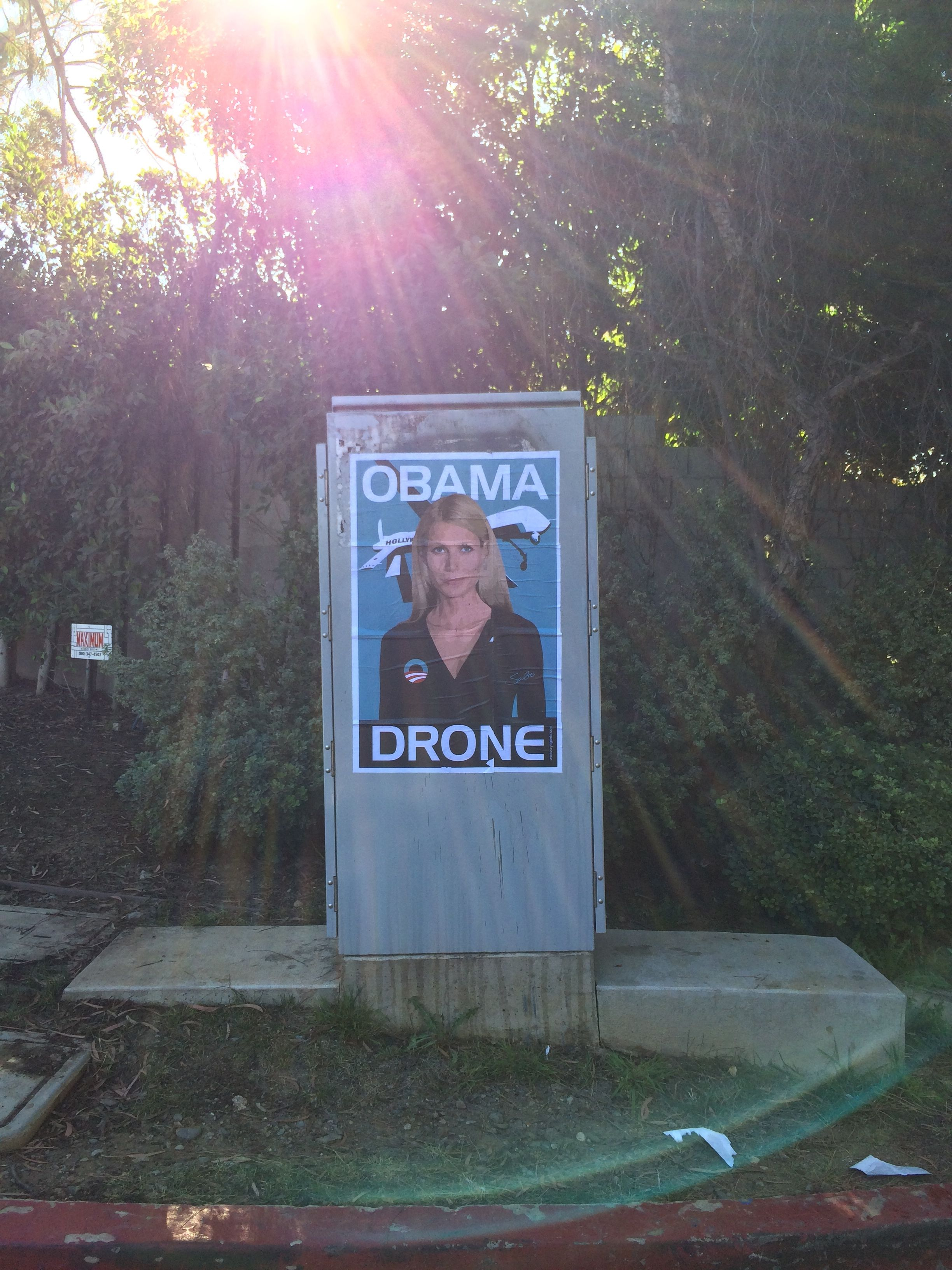 Gwyneth Paltrow Obama Drone posters poster Sabo President Obama DNC fundraiser L.A. Los Angeles Brentwood neighborhood neighbor neighbors hang hanging hung signs plaster plastering plastered traffic signal box boxes lamp posts bus benches anonymous conservative street artist provocative controversial subversive Unsavory Agents UnsavoryAgents outside political Democrats Democrat drones Predator plane planes flying background actor actress home house host hosting gala sun