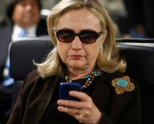 Hillary Clinton Blackberry sunglasses airplane email server scandal Secretary of State classified information